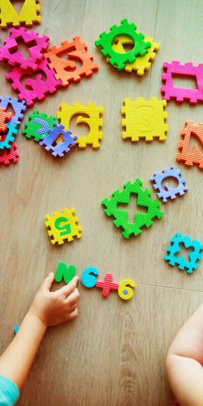 kids playing with puzzle, learning numbers and shapes, education